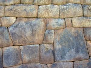 Inkojen kivimuuri Machu Picchu.